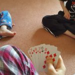 The boys teaching me cards the other morning