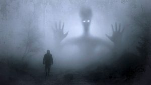 shadowy figure in front of a man in the mist