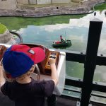 Youngest controlling a model boat at the Model Railway Village, Clonakilty