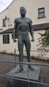 The statue of Danno O'Mahoney. He became the world heavyweight wrestling champion in 1935. Signature move: The Irish Whip